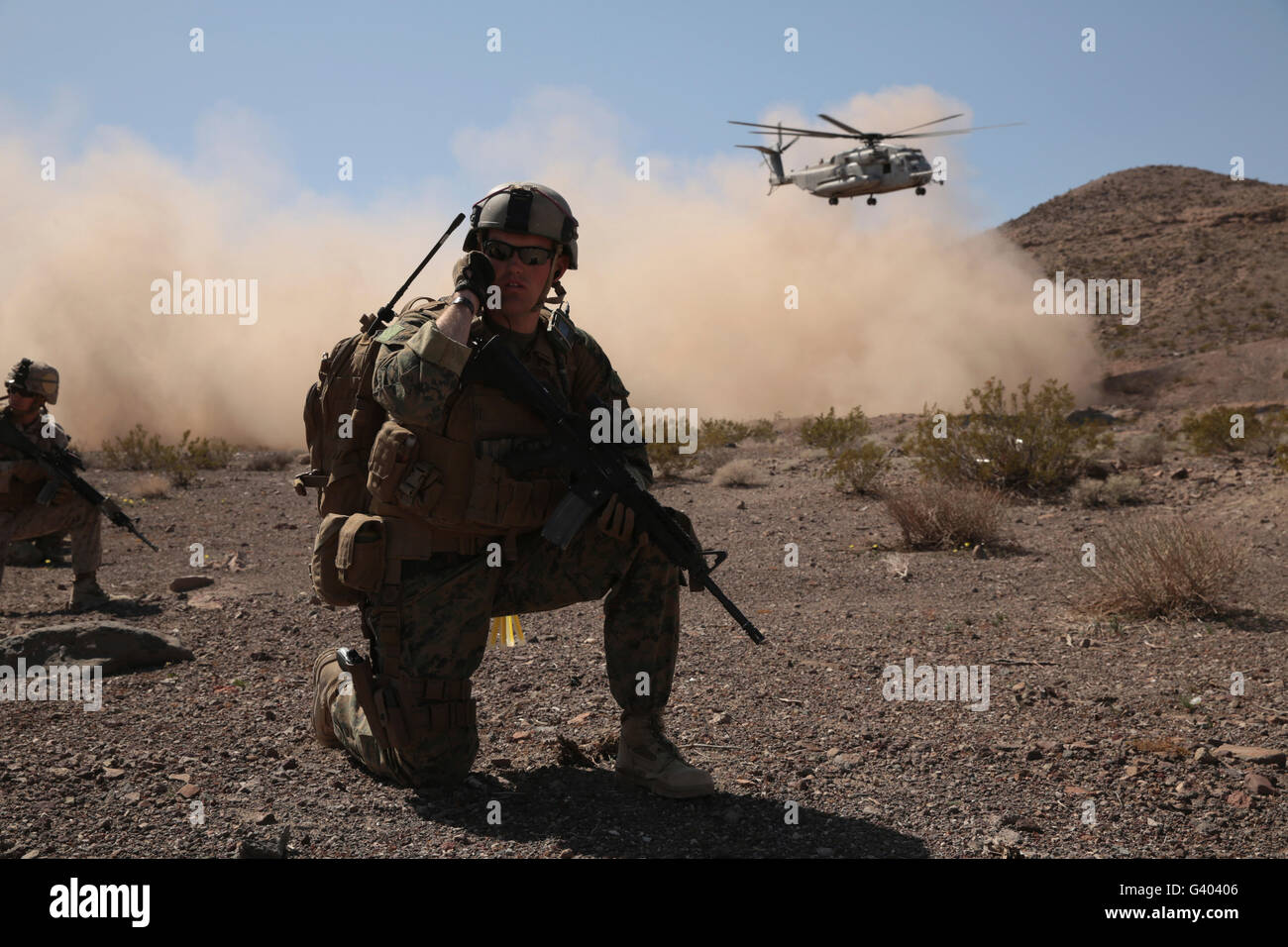 Solders are inserted by a CH-53 Super Stallion to the battlefield. - Stock Image