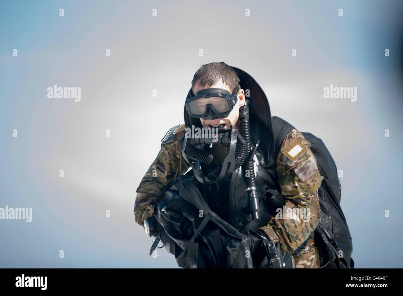 A Green Beret emerges onto Okaloosa Island. - Stock Image