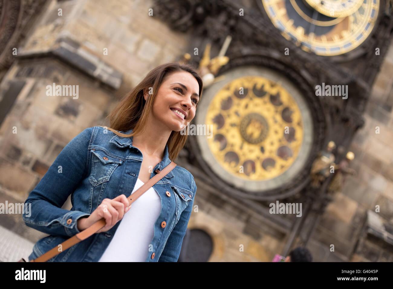 young woman enjoying her trip to Prague, czech republic - Stock Image
