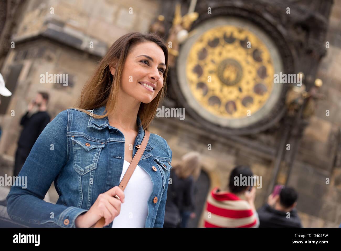 young woman enjoying a visite to Prague - Stock Image