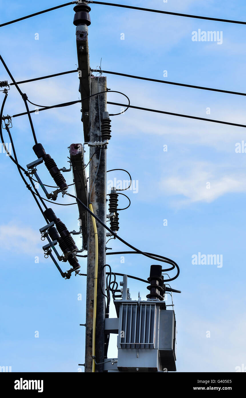 Electric pole connect to the high voltage electric wires on blue sky ...