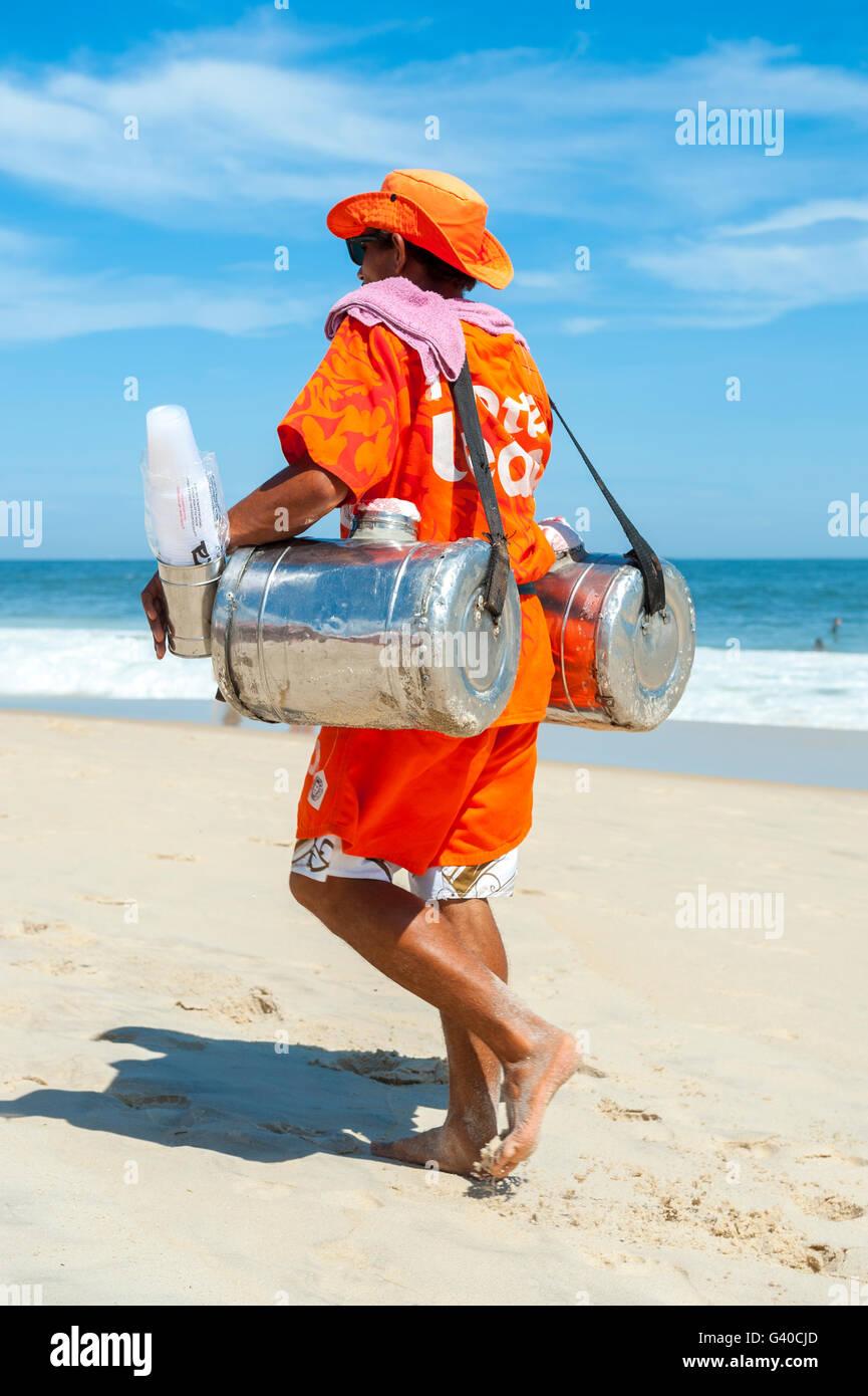 RIO DE JANEIRO - MARCH 15, 2015: Brazilian beach vendor selling South American mate tea walks in uniform in Ipanema. - Stock Image