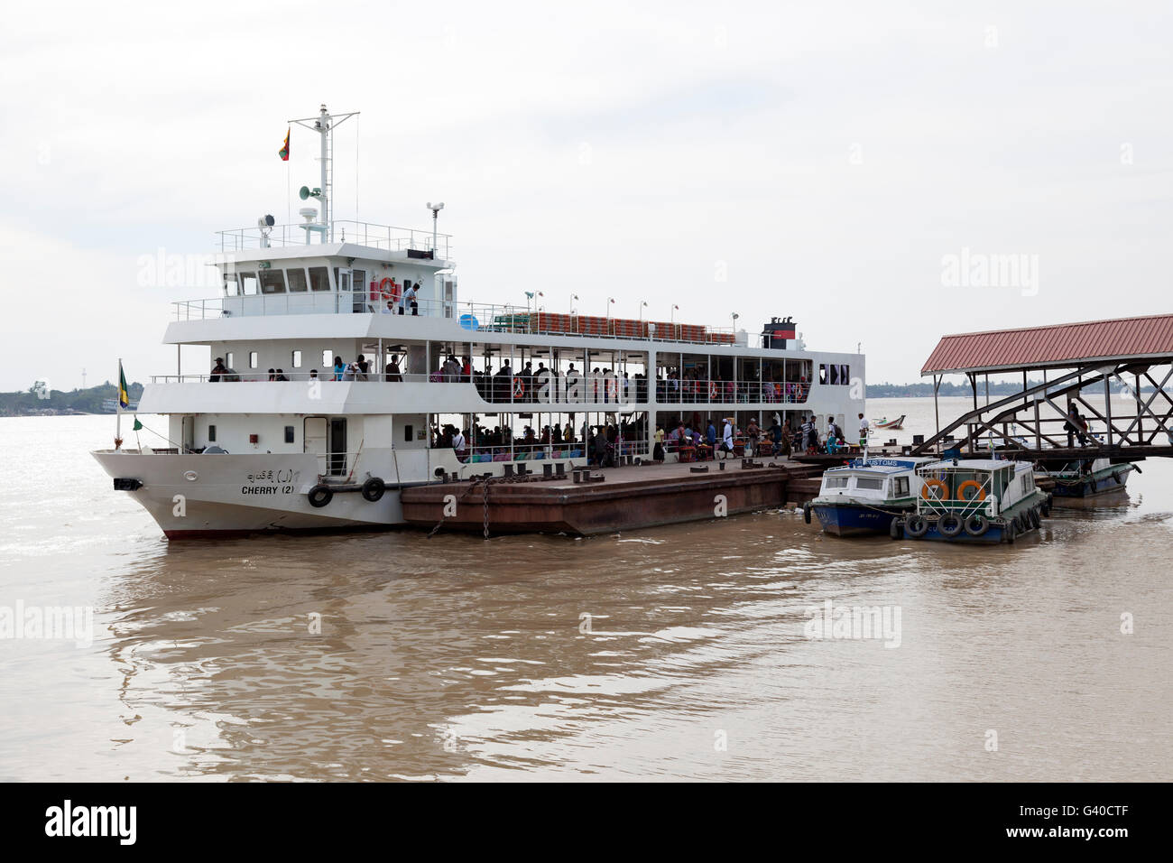 The Cherry two decker ferry-boat which commutes between Yangon (Pansodan jetty) and Dalah, on the other side of - Stock Image