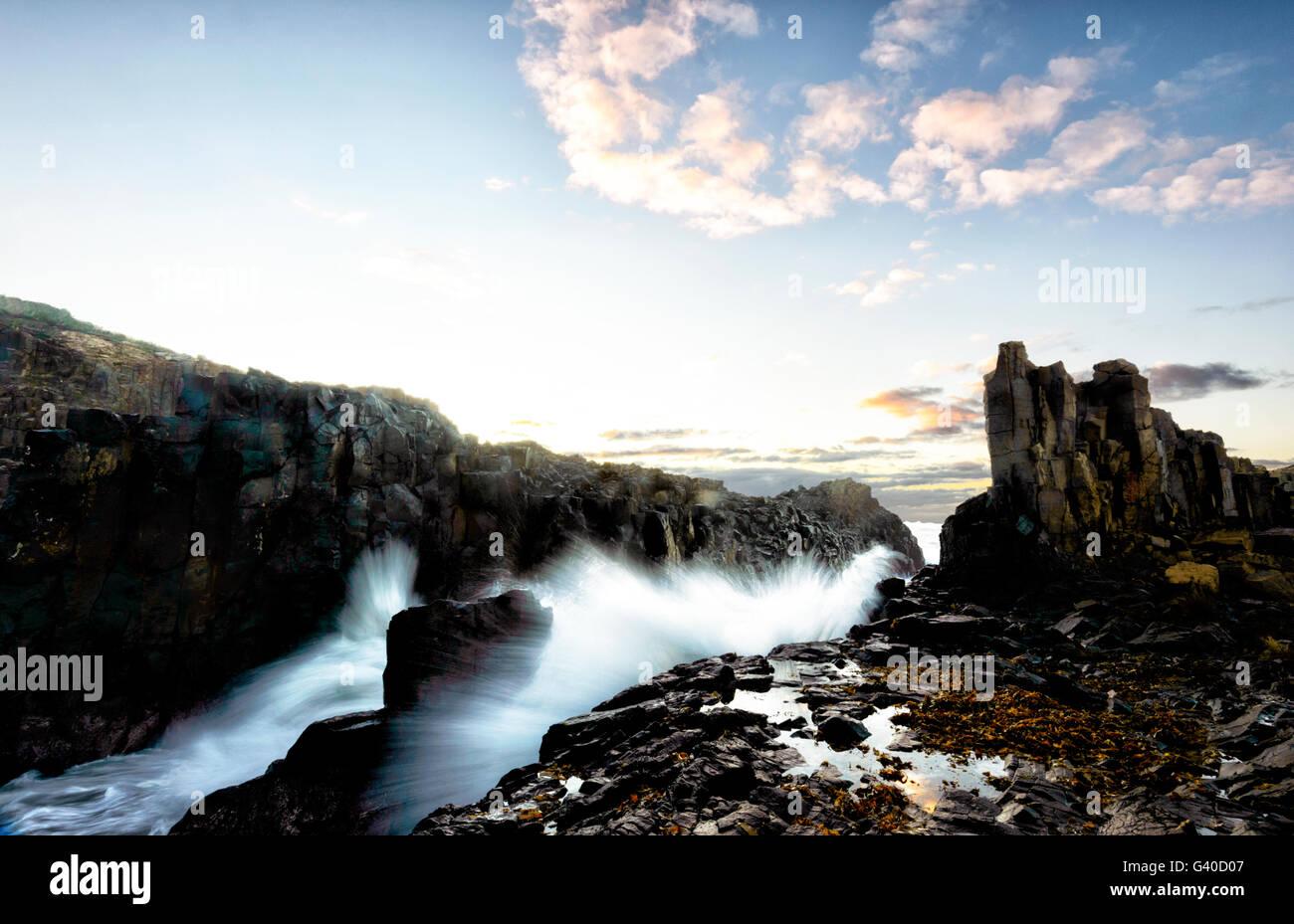 Motion blur at sunrise over Bombo Quarry Headland, Kiama, Illawarra Coast, New South Wales, NSW, Australia - Stock Image