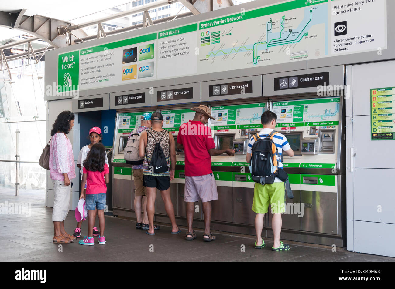 Commuters using Sydney Ferries ticket machines at Circular Quay, Sydney, New South Wales, Australia - Stock Image