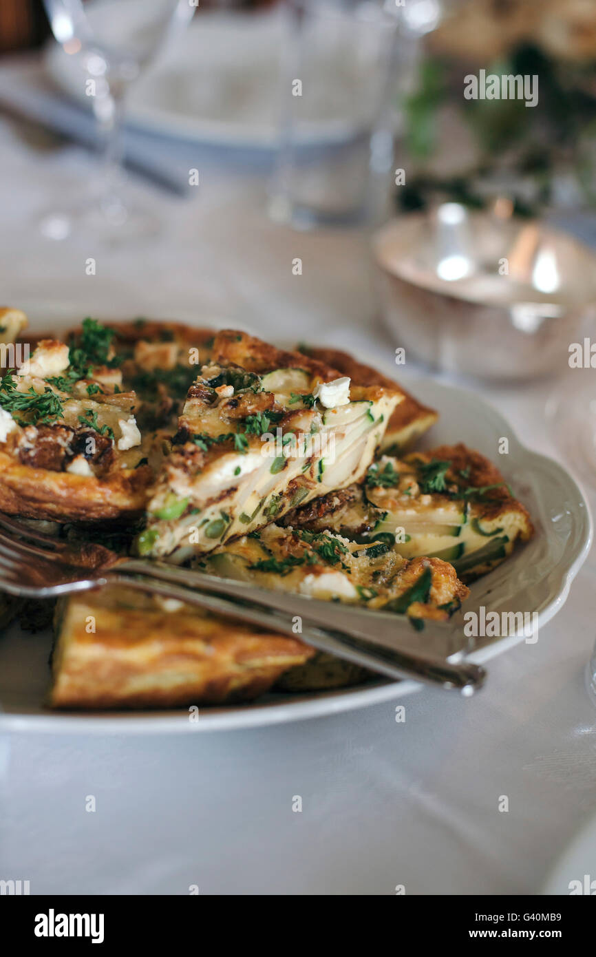 Frittata with vegetables and goat cheese on a plate for a light summer lunch - Stock Image