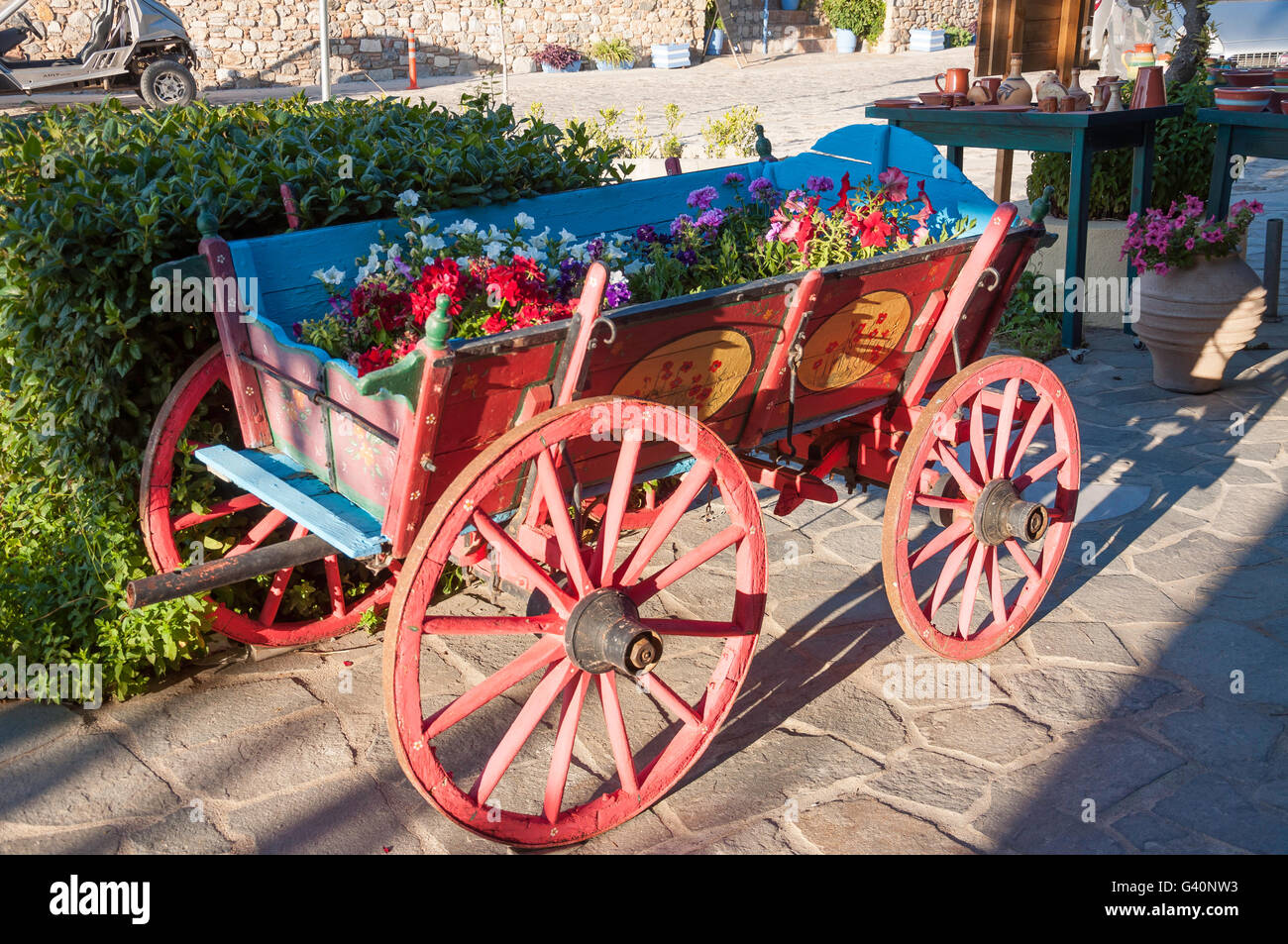 Wooden wagon with flowers in hillside village of Zia, Kos (Cos), The Dodecanese, South Aegean Region, Greece - Stock Image