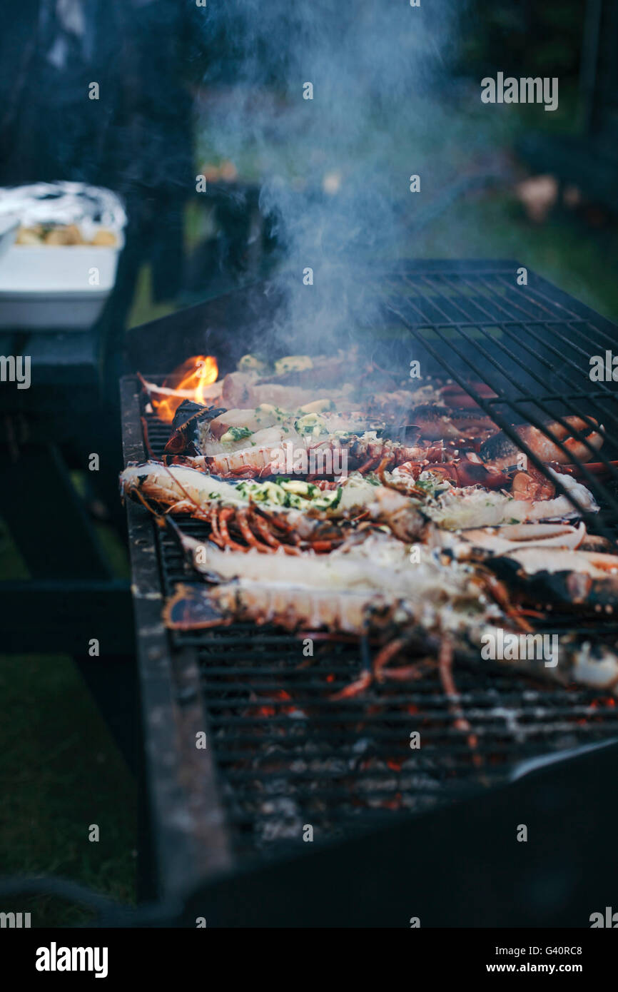 Lobster on grill - Stock Image