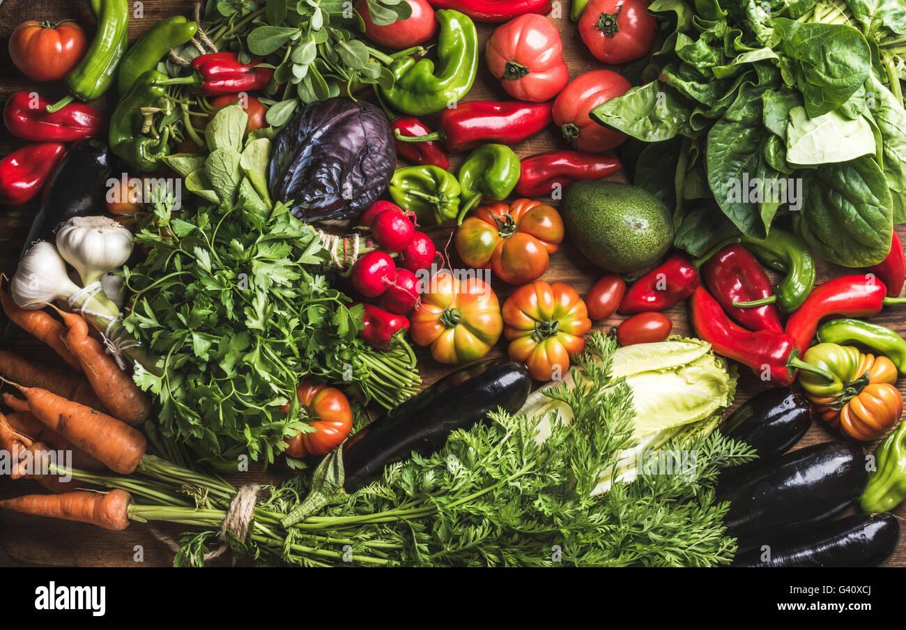 Variety of resh raw vegetable ingredients for healthy cooking or salad making, top view. Diet or vegetarian food - Stock Image