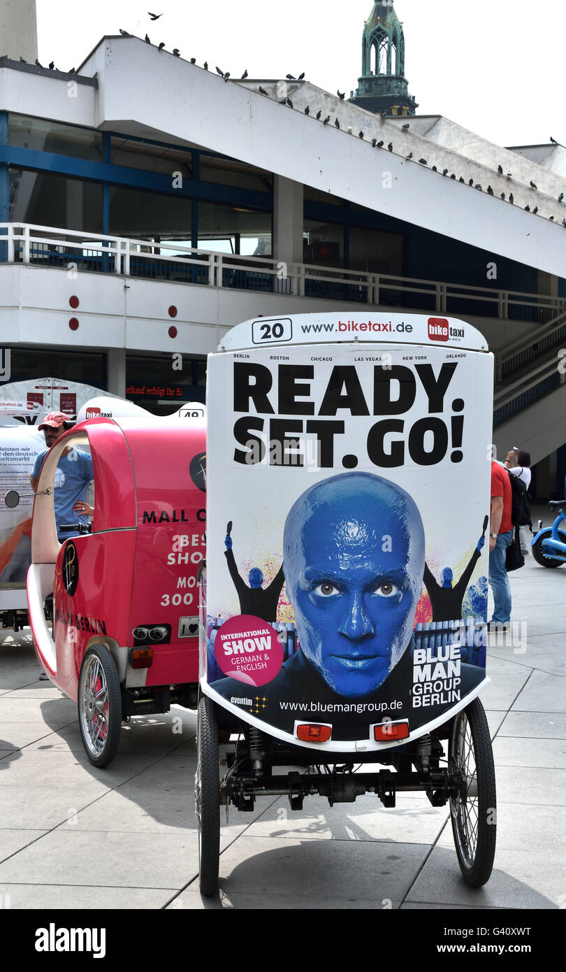 Blue Man Theater  Ready set to Go  tricycle Alexanderplatz Alexander Square Berlin Germany German - Stock Image
