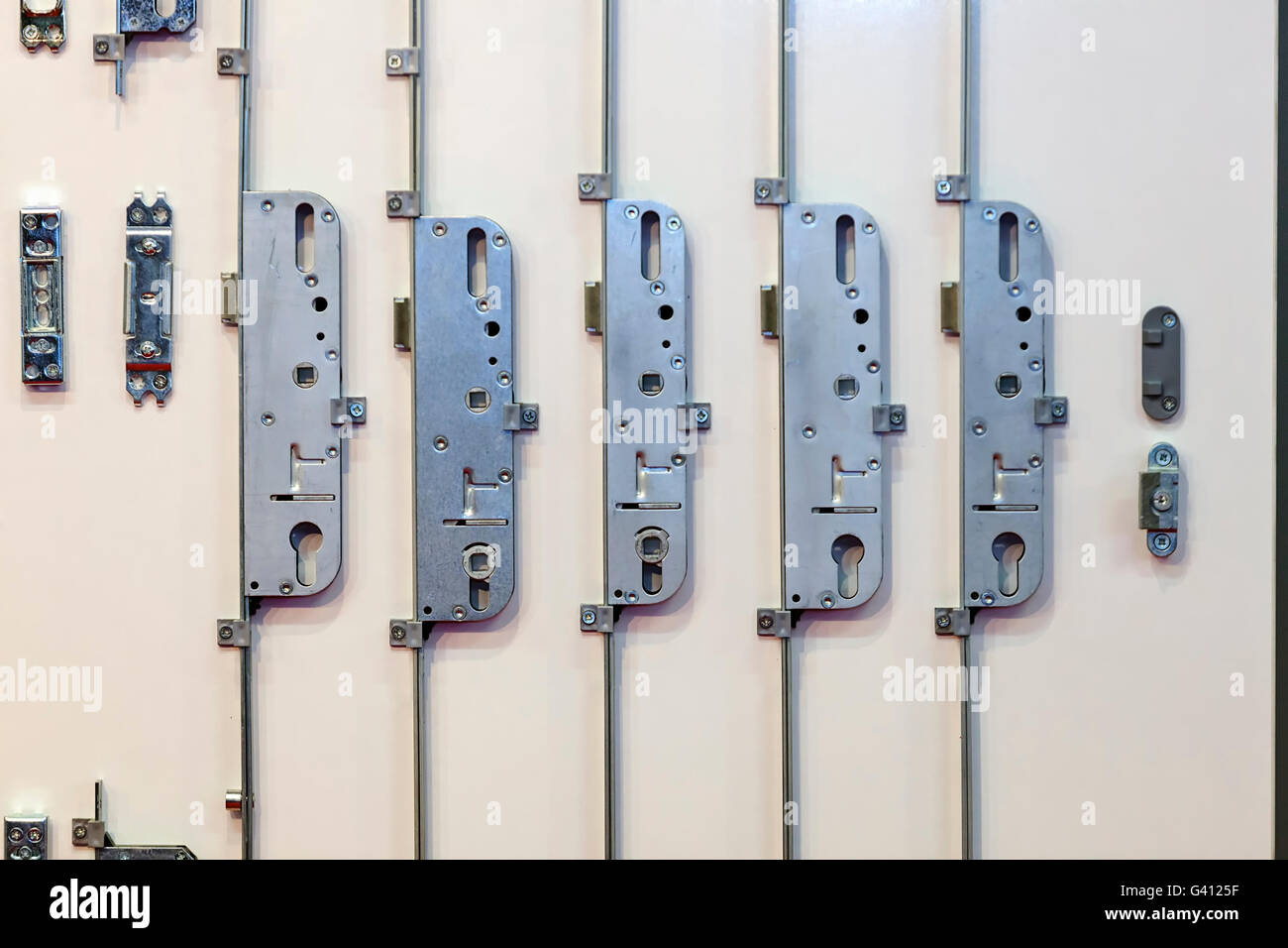 Five steel door lock mechanisms on exhibition - Stock Image