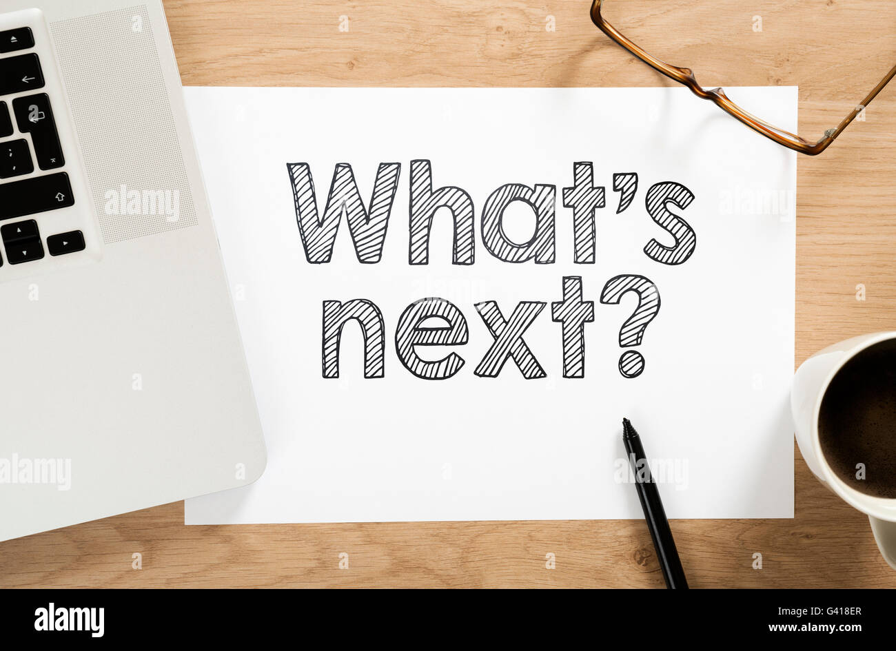 'what's next?' written paper on the office desk - Stock Image
