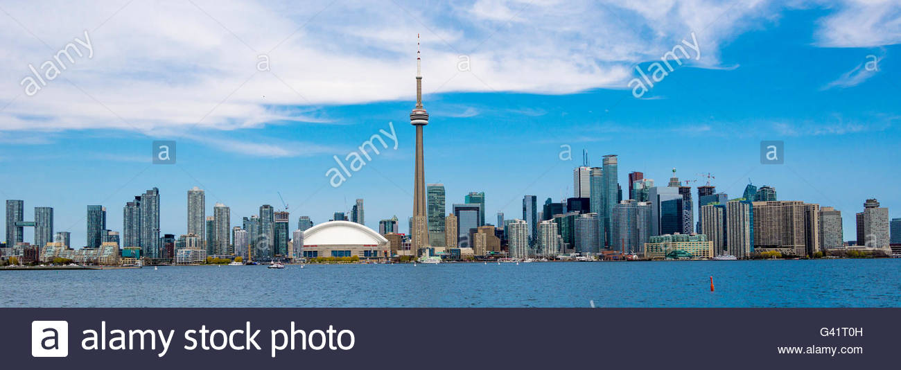 CN tower in Toronto skyline seen from Lake Ontario. The city offers boat tours which are very popular with tourists - Stock Image