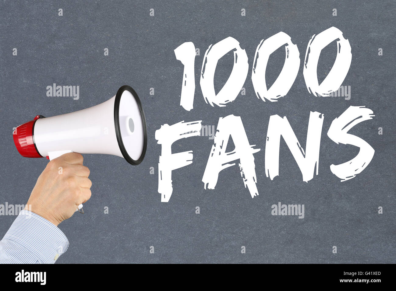 1000 fans likes social networking media hand with megaphone - Stock Image