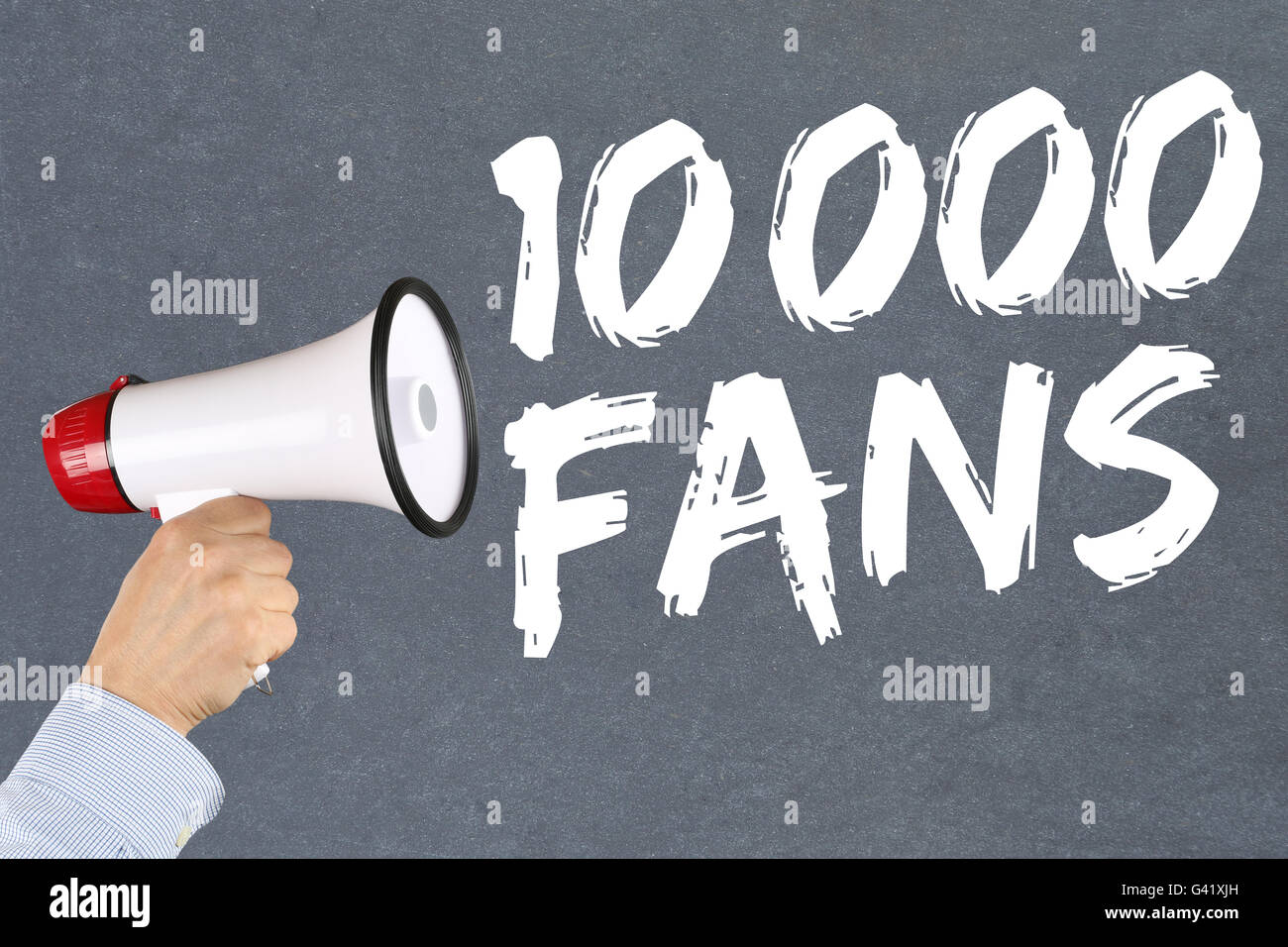 10000 fans likes social networking media hand with megaphone - Stock Image