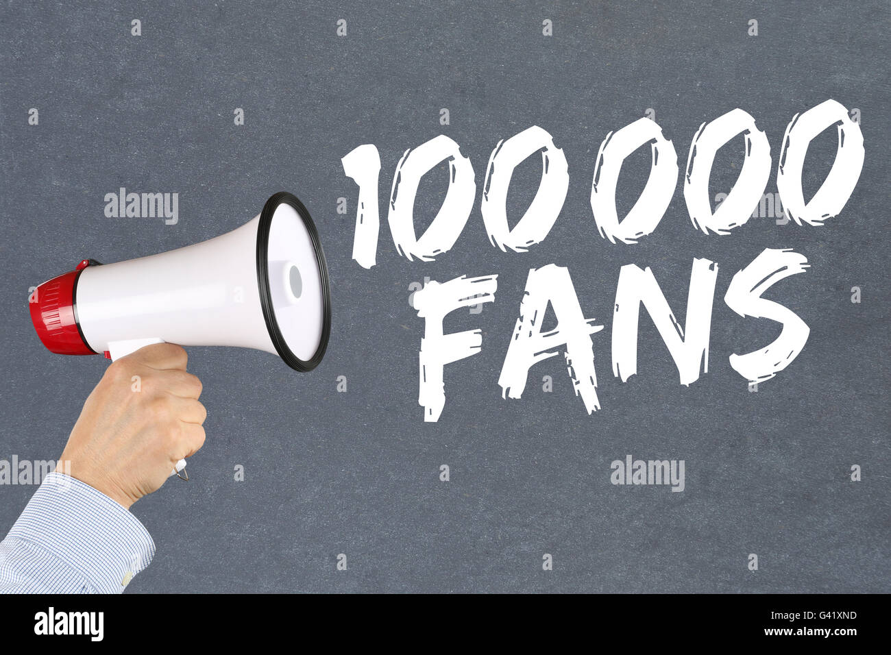 100000 fans likes social networking media hand with megaphone - Stock Image