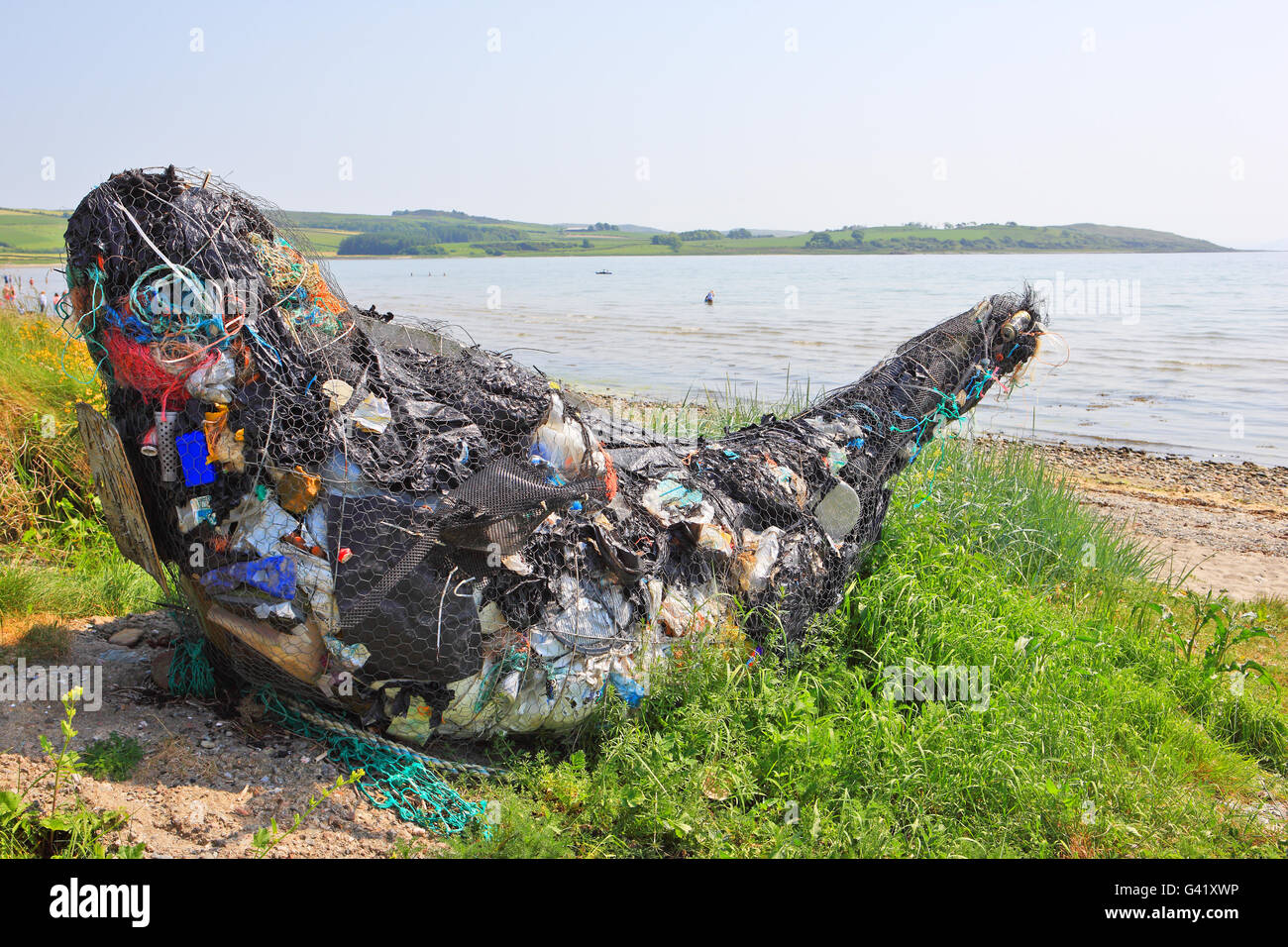 Whale sculpture at Ettrick Bay on Isle of Bute. It's made of flotsam and jetsam materials washed up on the shore - Stock Image