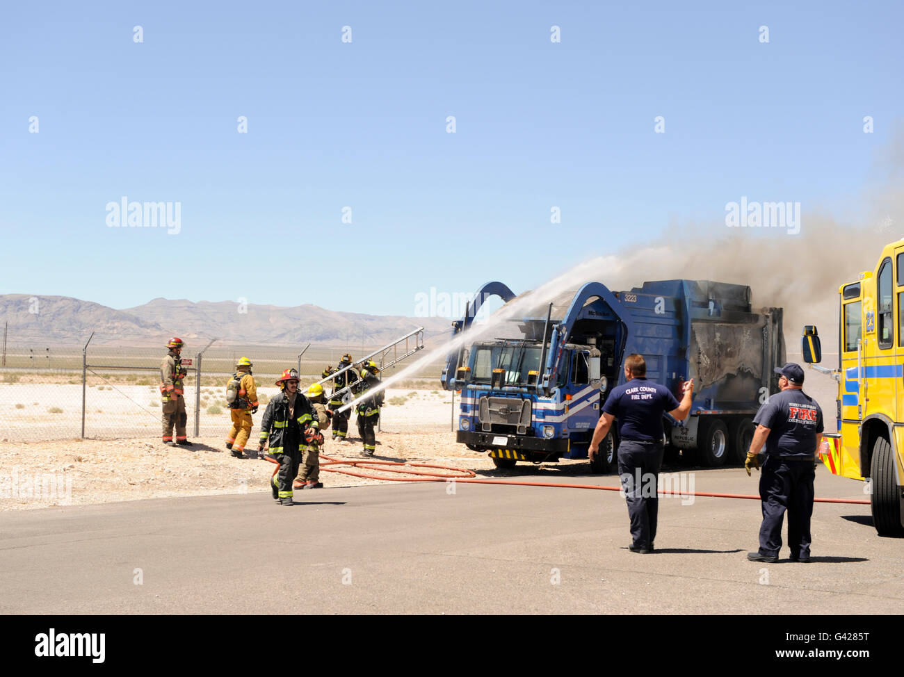 Las Vegas, Nevada, USA. 17th June, 2016. North Las Vegas Fire Department battle a garbage truck on fire at the Nevada - Stock Image