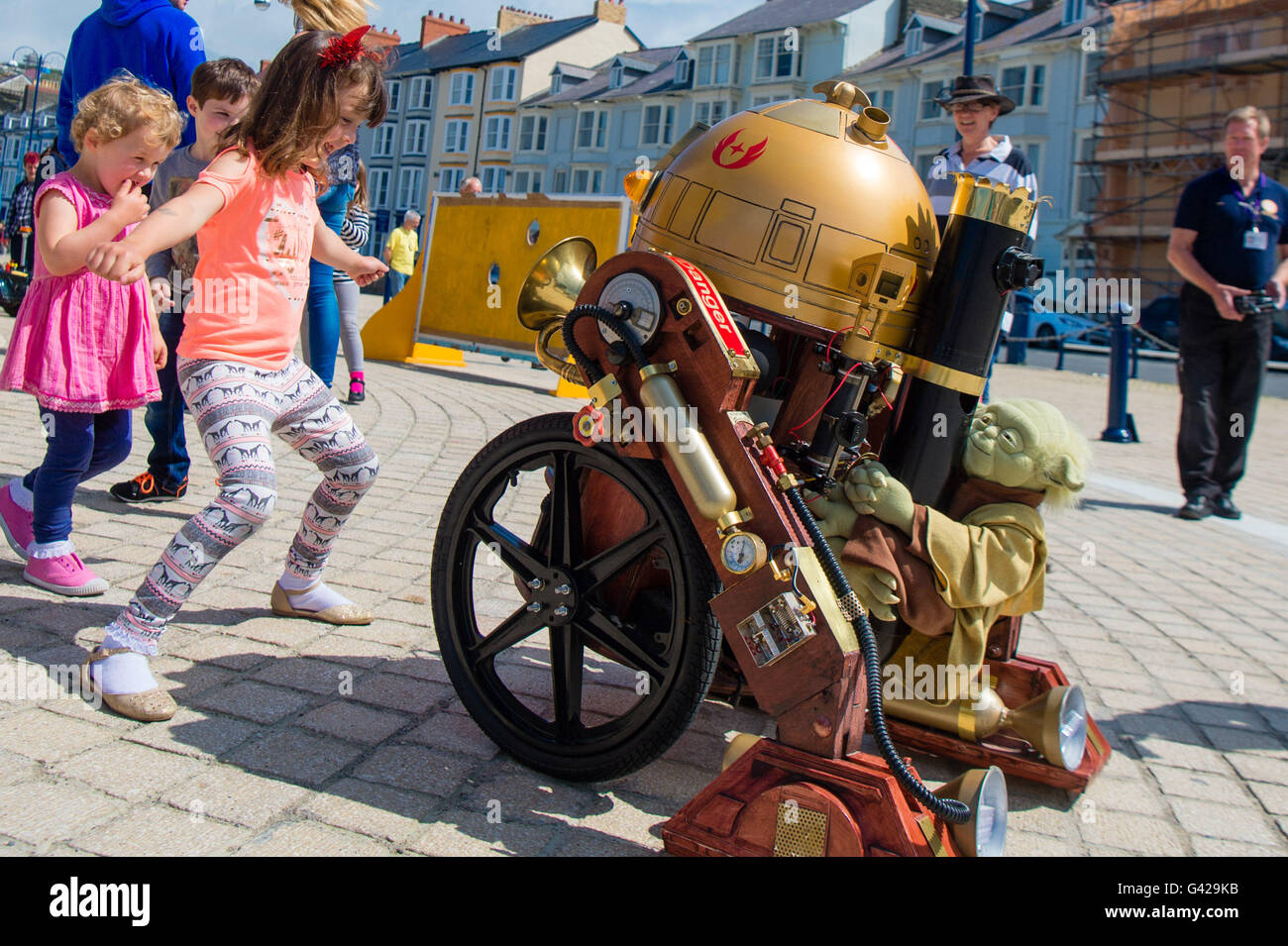 Aberystwyth Wales UK, Saturday 18 June 2016 Children interacting with a 'steam punk RD-D2' replica robot - Stock Image