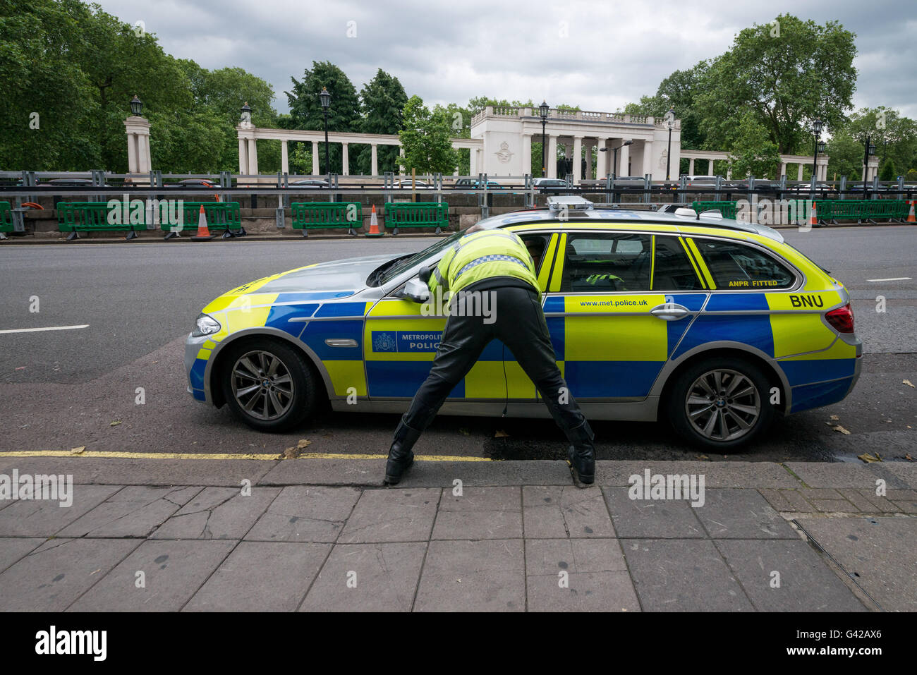 London, UK. 18th June, 2016. Police officer talking to his colleague in the car during the protest in London © Velar Stock Photo