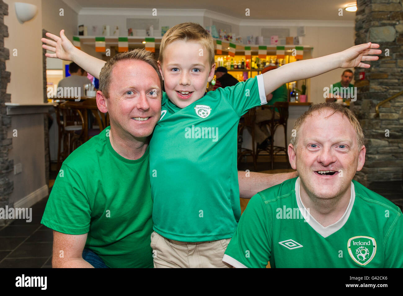 Skibbereen, West Cork, Ireland. 18th June, 2016. Ireland fans Adrian, Conor and Brendan O'Brien, all from Skibbereen, - Stock Image