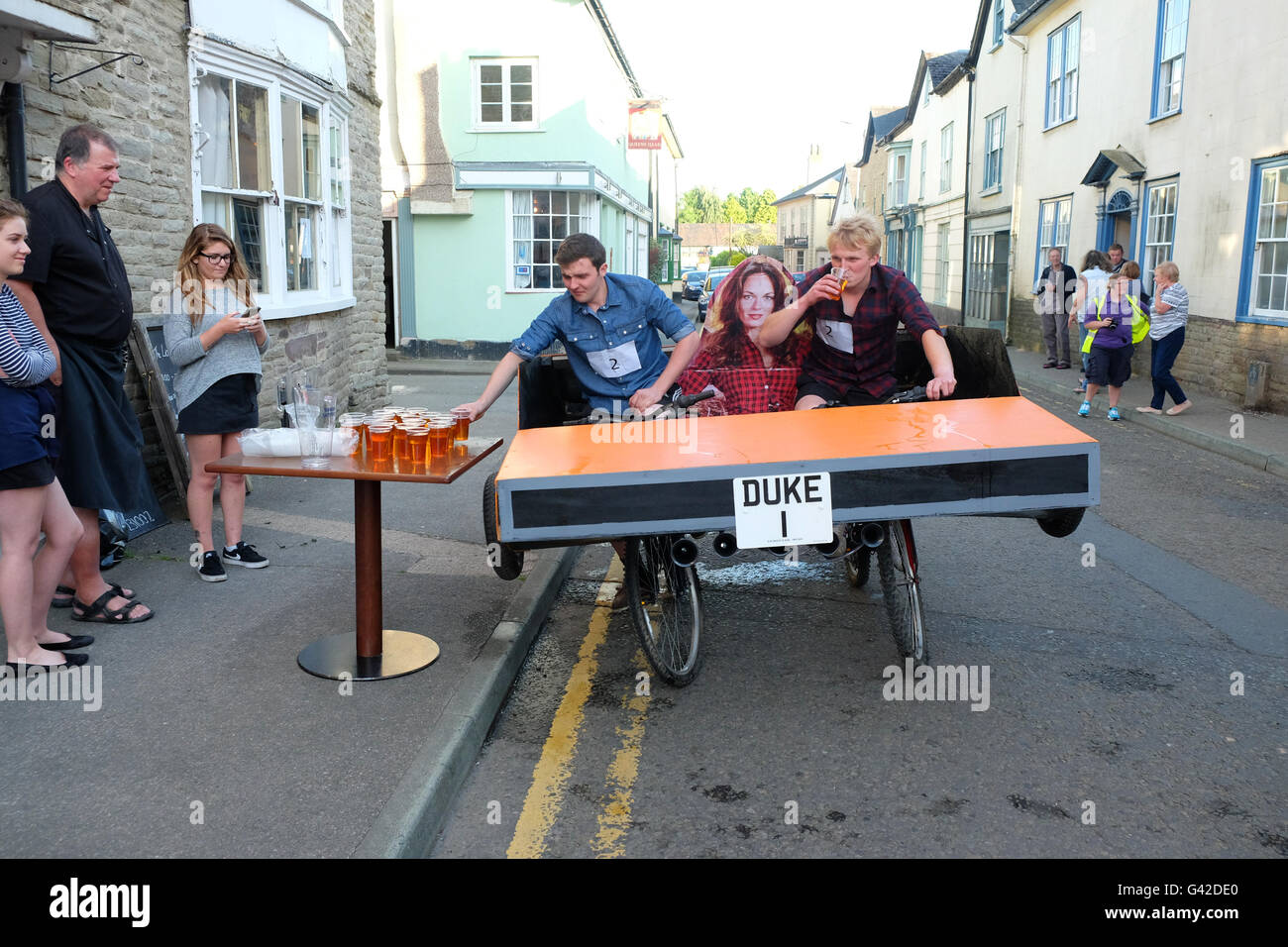 Kington, Herefordshire, UK - Saturday 18th June 2016 - The Dukes of Hergest team stop for a beer during the 40th - Stock Image