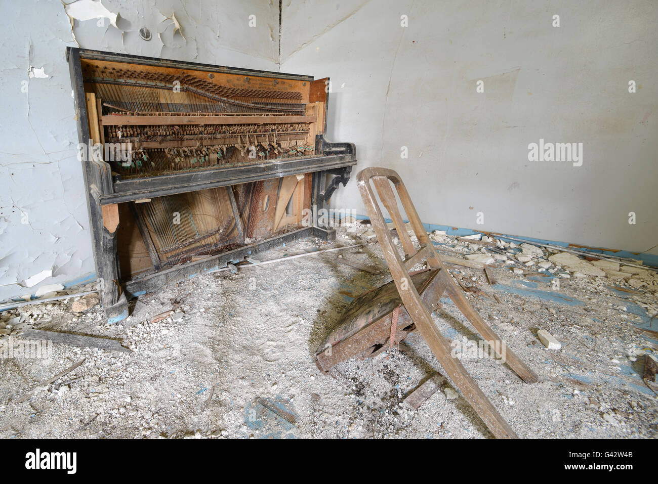 broken piano and chair in abbondoned house Lesvos Greece Stock Photo