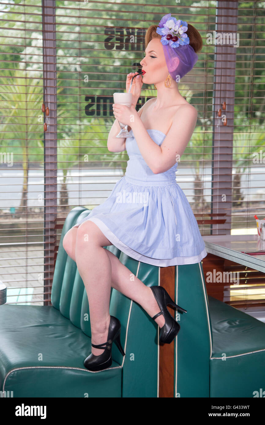 1960s look pin up girl in an american diner stock photo 105789764 alamy. Black Bedroom Furniture Sets. Home Design Ideas