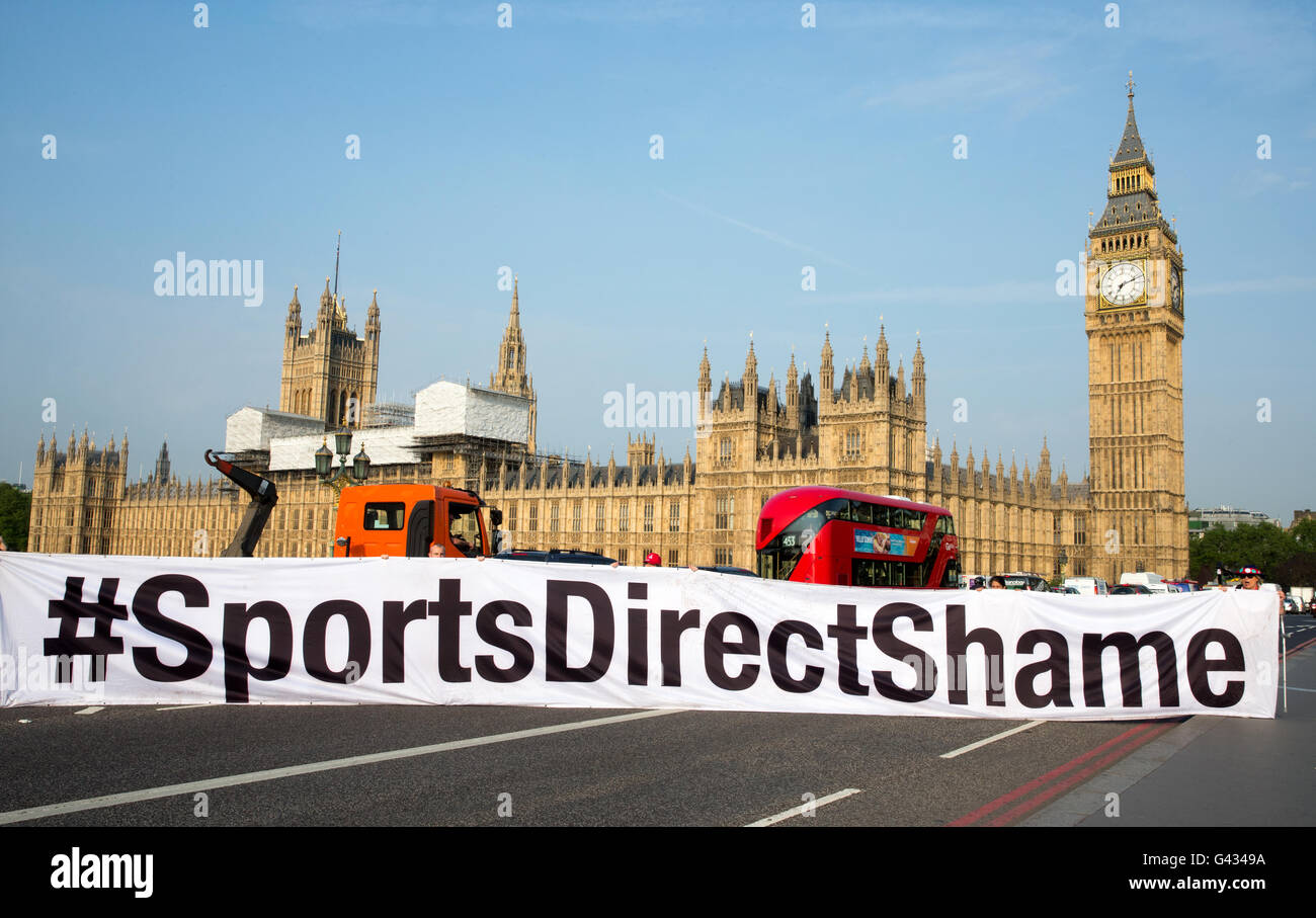 'Sports Direct shame' banner highlighting poor working conditions at Sports direct.The owner Mike Ashley - Stock Image
