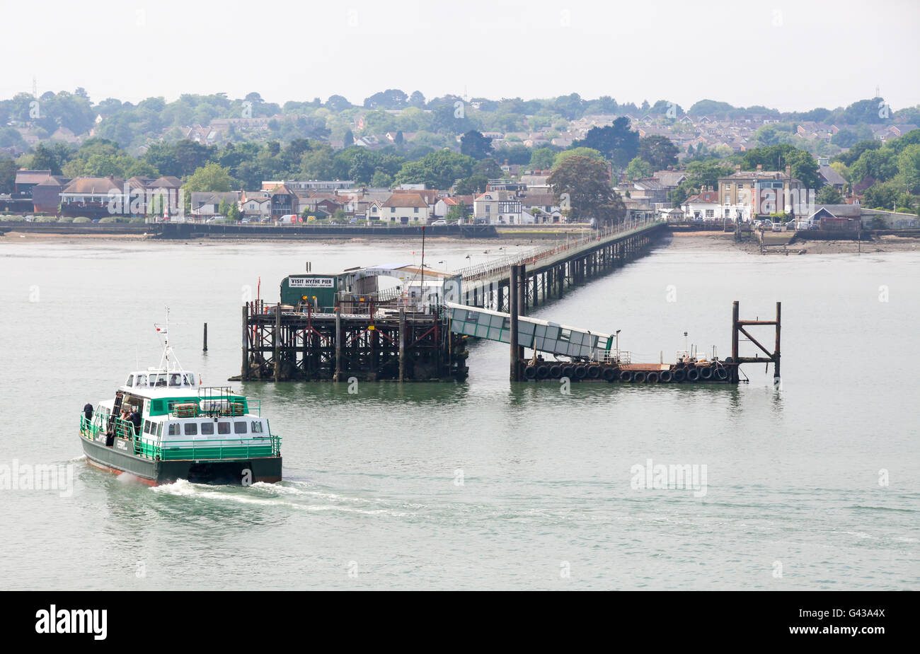 Hythe Ferry arriving at Hythe Pier, Hampshire, UK - Stock Image