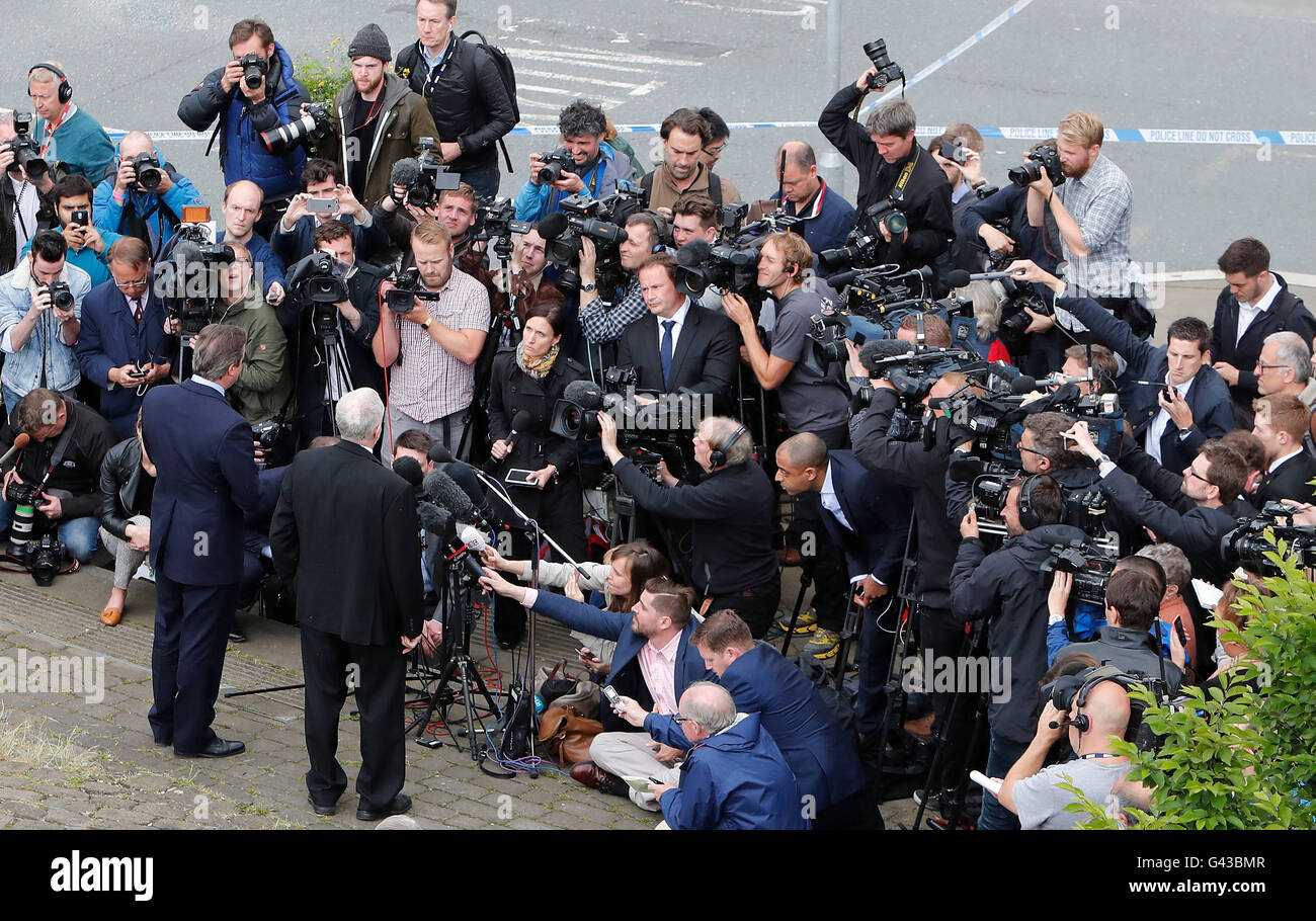 Prime Minister David Cameron (left: back to camera) and Labour Party leader Jeremy Corbyn speak to the media after - Stock Image