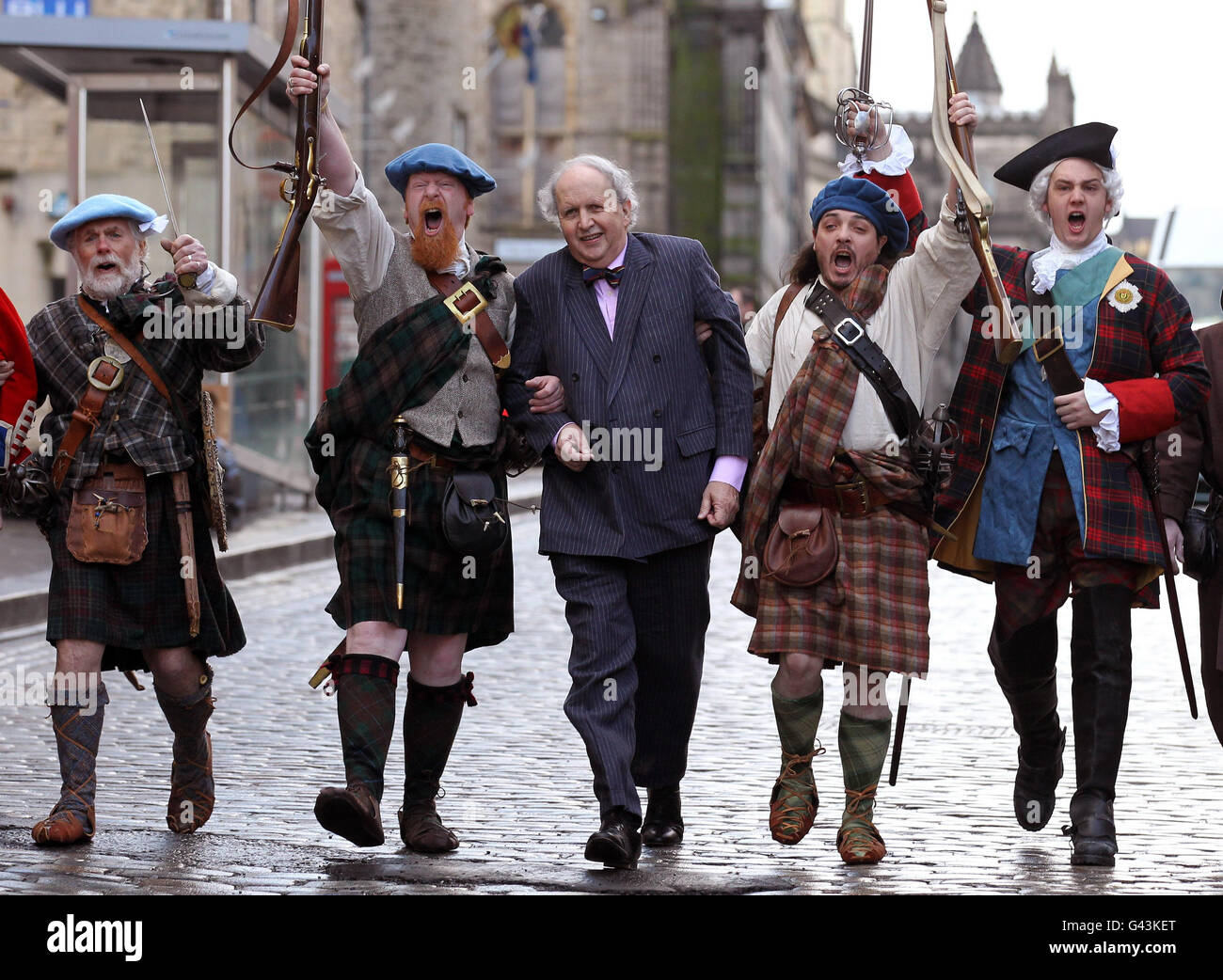 Alexander McCall Smith joins Jacobite Highlanders to mark the launch of a 5 million funding appeal to Parliament Stock Photo
