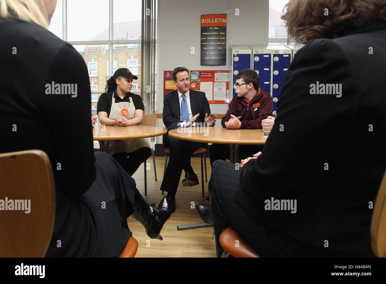 Prime Minister David Cameron speaks with staff members during a visits to a branch of Sainsbury's supermarket in Stock Photo