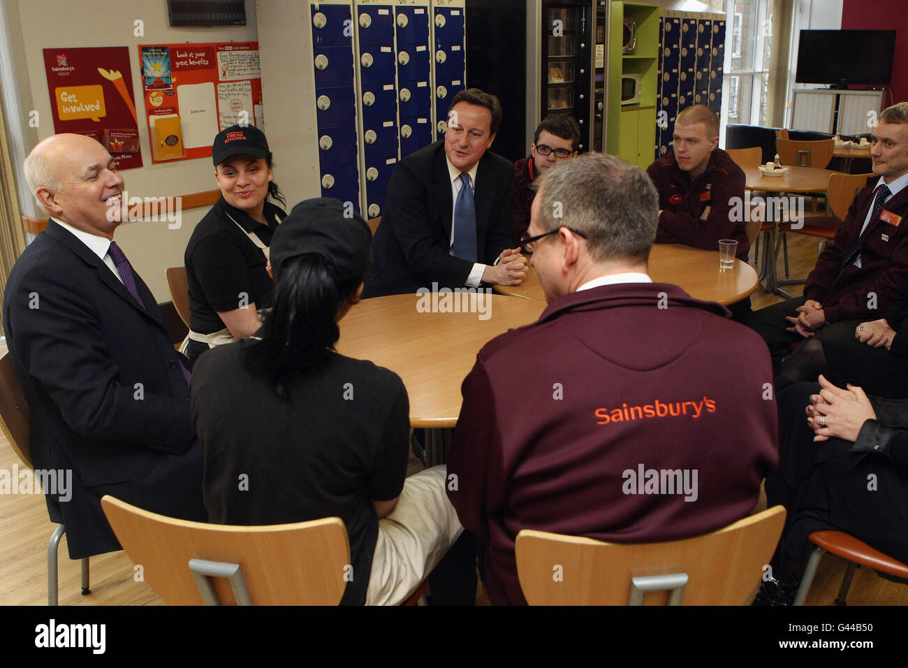 Prime Minister David Cameron and Work and Pensions Secretary Iain Duncan Smith speaks with staff members during Stock Photo