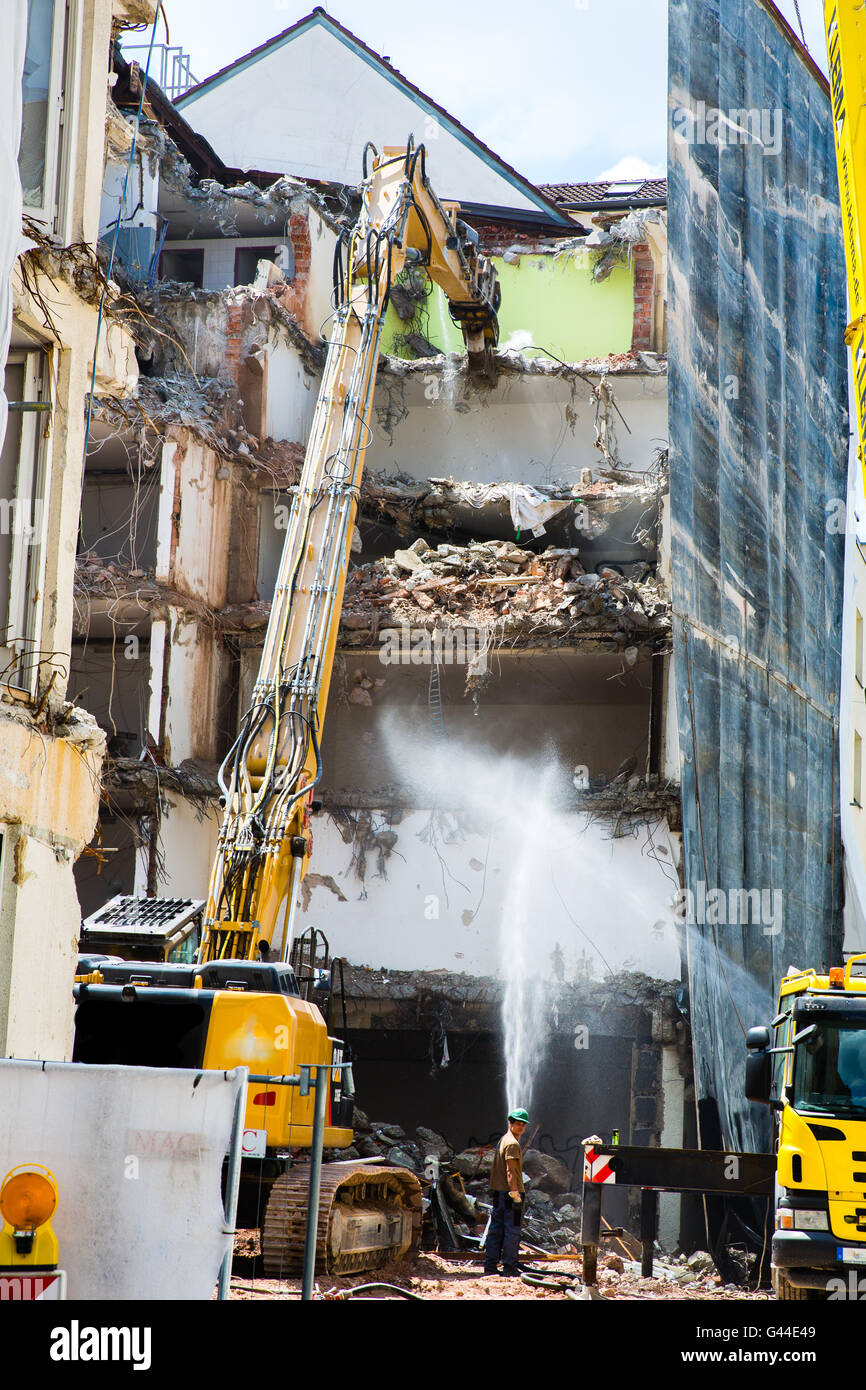 Dismantling of Building crashing by machinery - Stock Image
