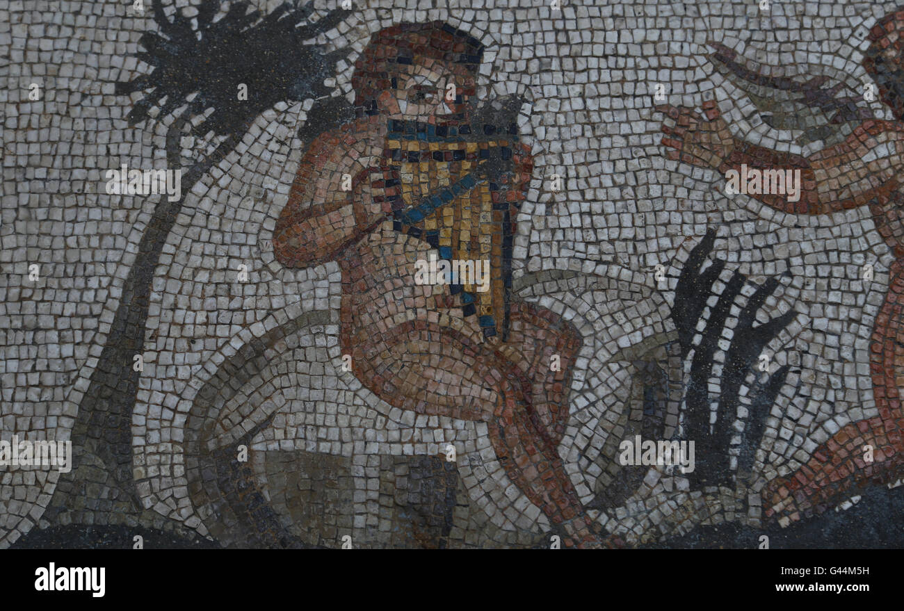 Mosaic of the Four Seasons. C. 325 AD. Found in Daphne (now Antakya, Turkey). Detail: Eros playing a pan flute. - Stock Image