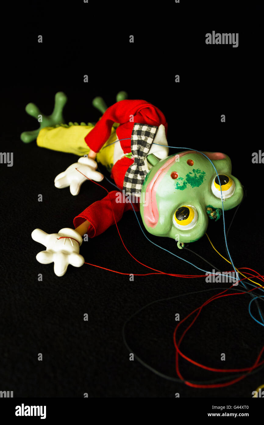 An old Pelham frog puppet lying abandoned - Stock Image
