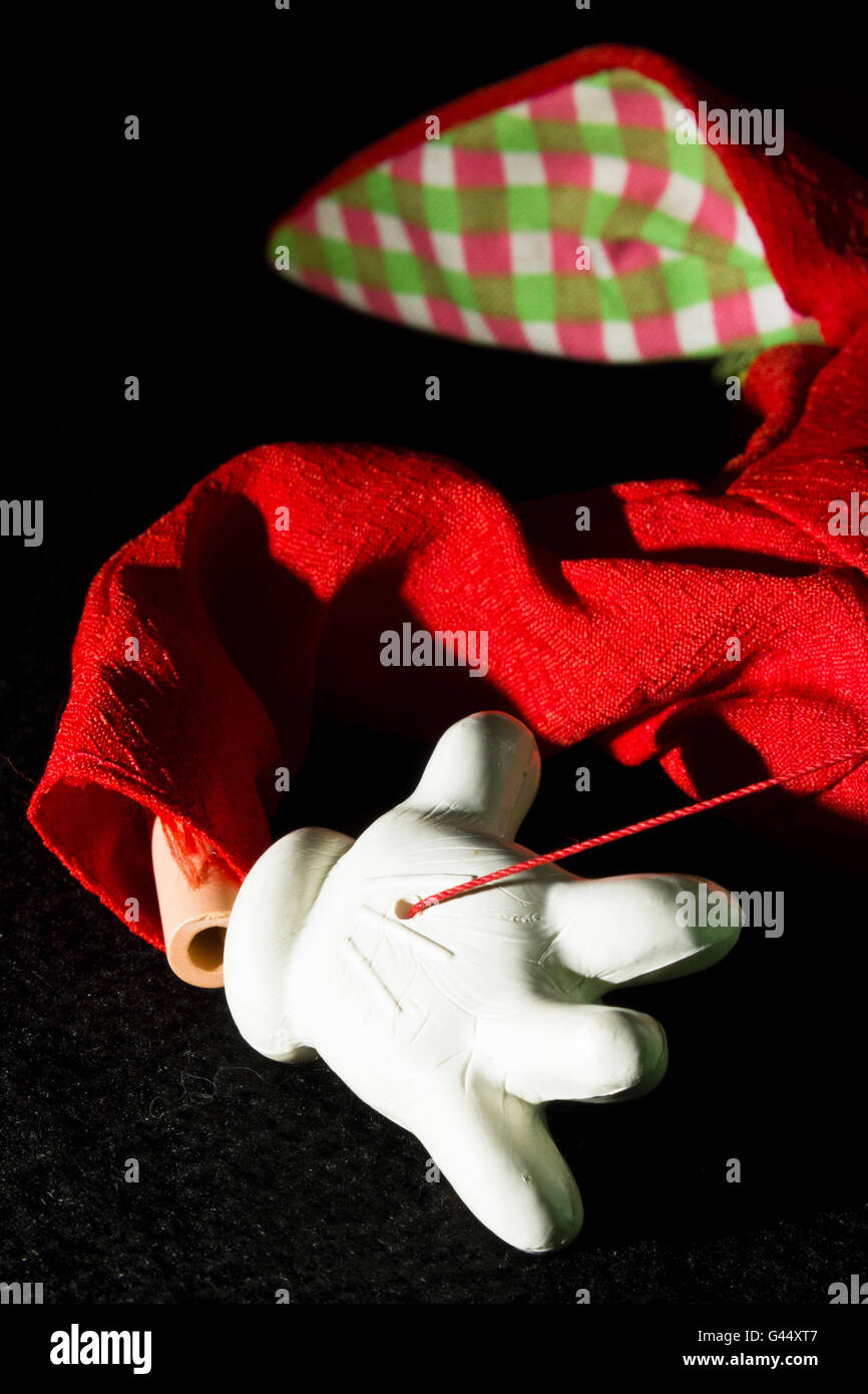Close-up of a string puppet lying abandoned. - Stock Image