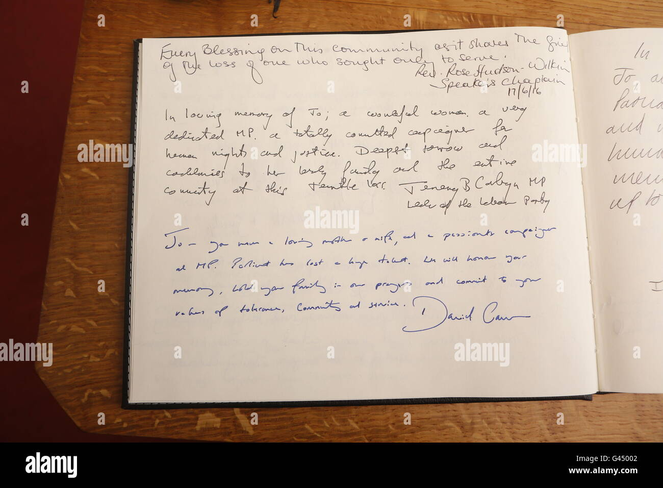 Messages of condolence written by Prime Minister David Cameron and Labour Party leader Jeremy Corbyn in a book of - Stock Image