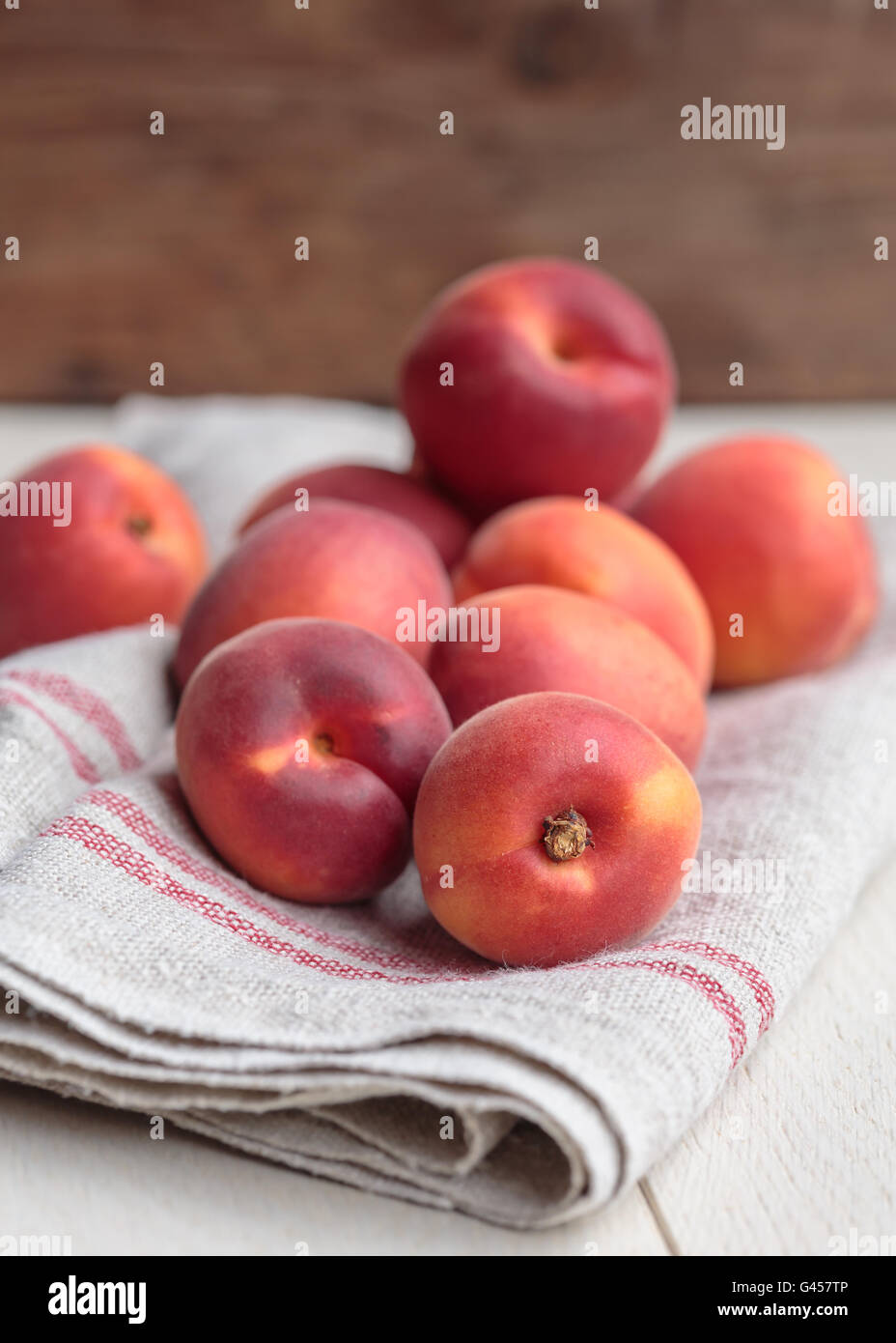 Red apricots on kitchen towel - Stock Image