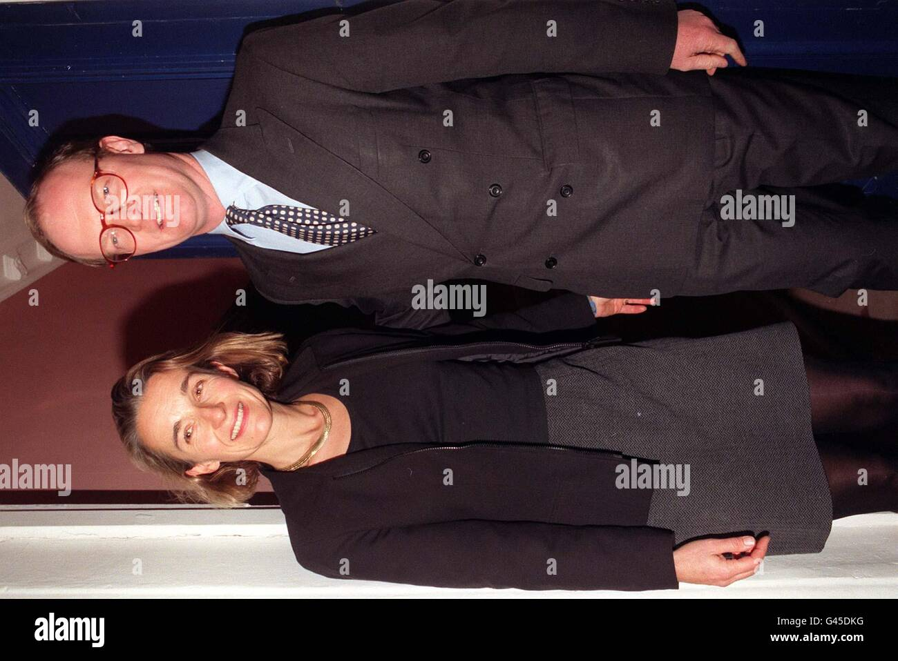 David Willetts with his wife Sarah pictured outside his London home this evening (Wed) hours after resigning as Paymaster General. Willetts quit office within minutes of publication of a report which accused him of dissembling - a word which can mean concealing or being insincere - before a Commons committee. Stock Photo