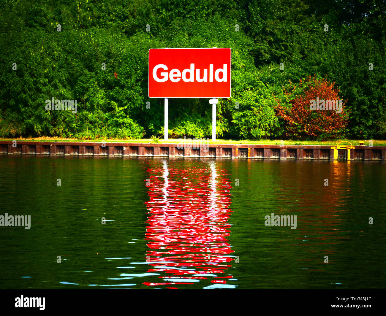 Europe Germany NRW Sluice Canal sign of Geduld Be Patient - Stock Image