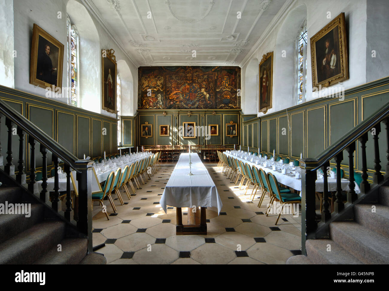 The Dining Hall at Jesus College, Cambridge. View towards painting of Royal Crest on far wall. Three long tables - Stock Image