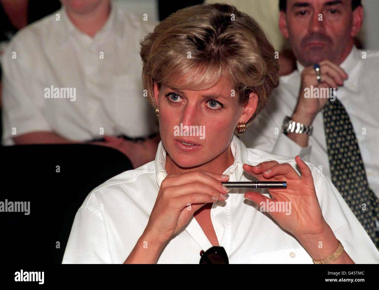 Diana, Princess of Wales, listens intensely as she attends an engagement in the Angolan capital of Luanda today - Stock Image