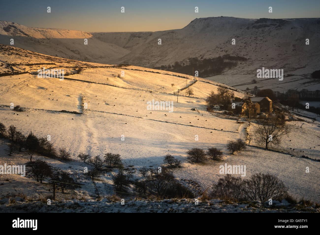Farm and winter snow, Greenfield, Saddleworth, UK, near sunset - Stock Image