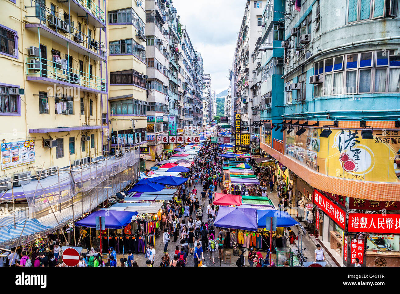 HONG KONG - JUL 26, 2015: The busy Fa Yuen street market in Hong Kong is popular with tourists and locals alike. - Stock Image