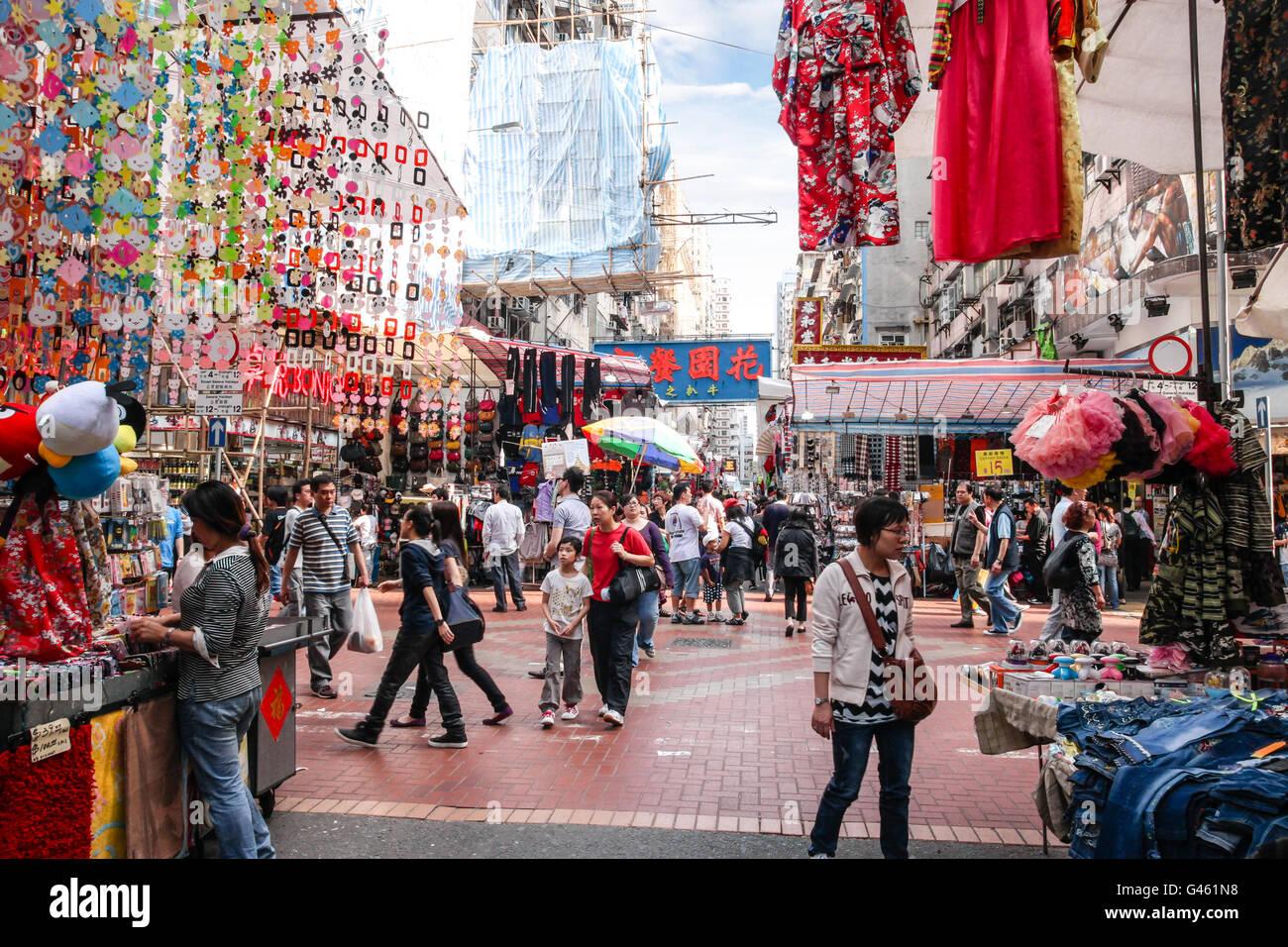 Hong Kong SAR, China - April, 14 2011: Busy shoppers stroll along the Fa Yuen Street market in Mong Kok, Hong Kong. - Stock Image