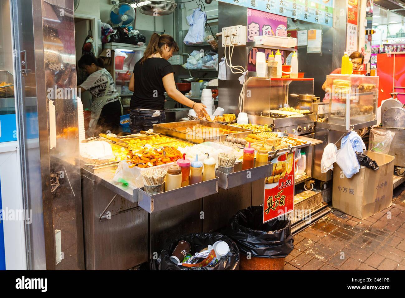 Hong Kong SAR, China - July 26, 2015: A street vendor selling popular snacks at Fa Yuen Street market in Kowloon. - Stock Image