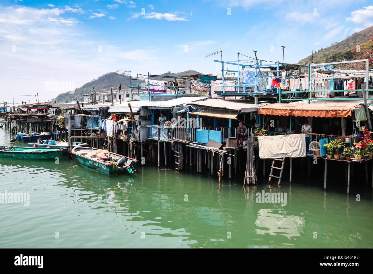 Hong Kong - April 10, 2011: Houses on stilts above the tidal flats of Lantau Island are homes to the Tanka people - Stock Image