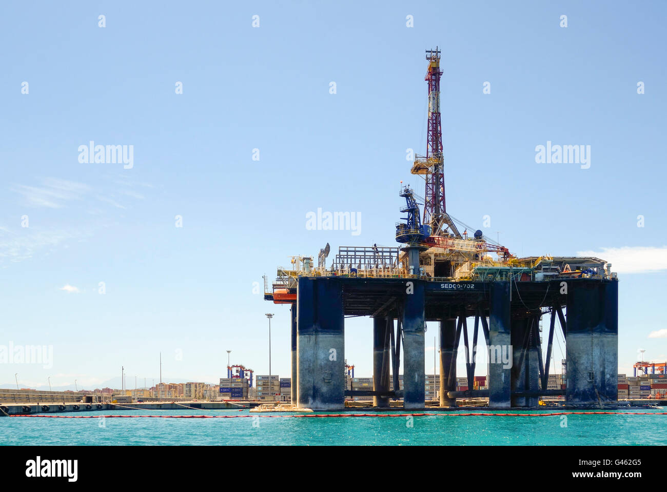 Oil rig Sedco 702, from Liberia moored in Port of Malaga, docked, to be dismantled, Andalusia, Spain. Stock Photo